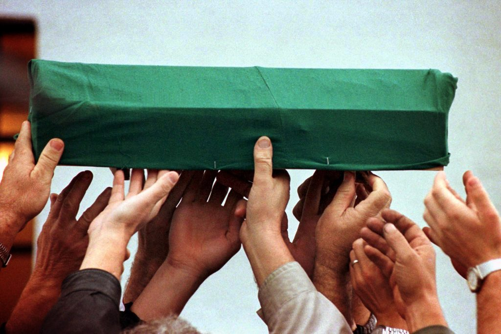 SARAJEVO 22OCT96- Bosnian Moslems carry a small coffin with body of 40 days old daughter of local Moslem priest in the village of Svrake, some 15 km north-west from Sarajevo, October 22. Hasib Ramic, Moslem priest from the village of Semizovac, was killed together with his wife and four children in may of 1993. They corps were exumated from a mass grave last week. photo by Damir Sagolj